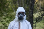 man in a respirator and white body suit