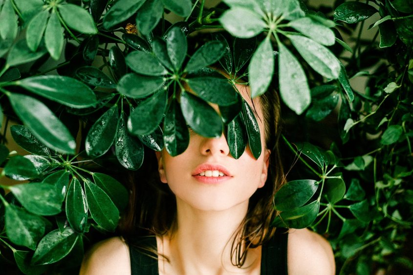 girl with leaves over her eyes