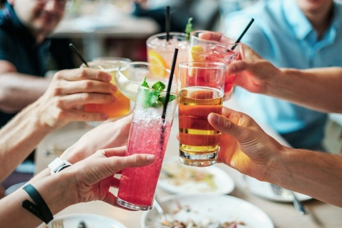 group people holding drinks colorful